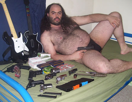 weird ass guy with guns and guitar - pichars.org